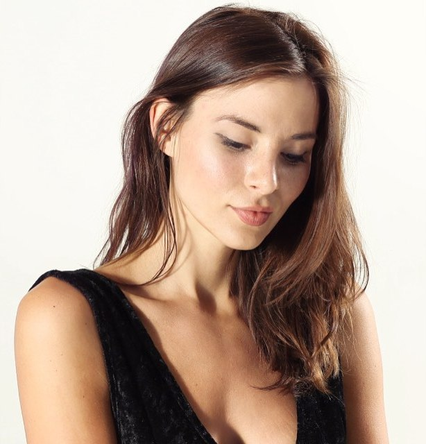 Actress Kacey Barnfield looking pretty against a white background