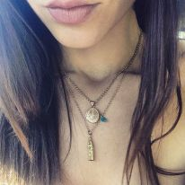 Kacey Barnfield with a gold Big Ben necklace