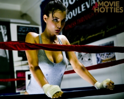 Kacey Barnfield in a boxing ring with her hands on the ropes