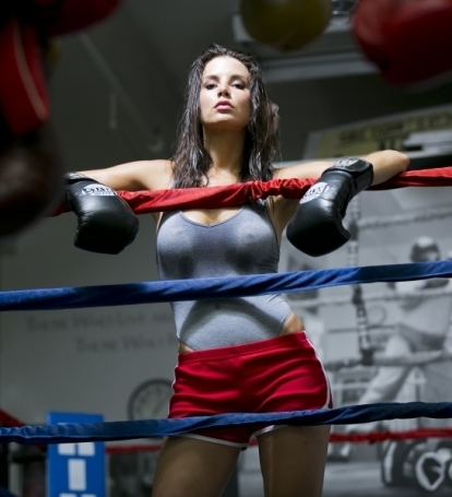 Kacey Barnfield looking sexy with her arms on the ropes of a boxing ring