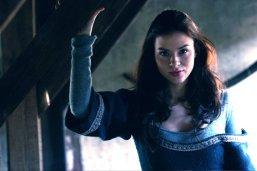 Kacey Barnfield in blue medieval dress