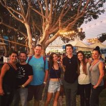 Kacey Barnfield standing with a group of friends in front of a tree
