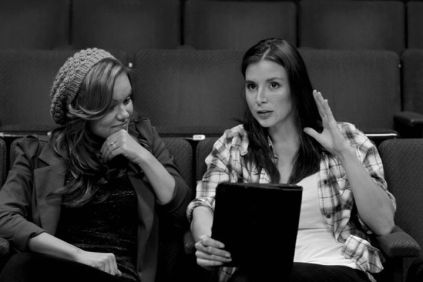 Kacey Barnfield talking to Anya Monzikova during a rehearsal