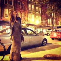 Kacey Barnfield standing in a Chicago street at night
