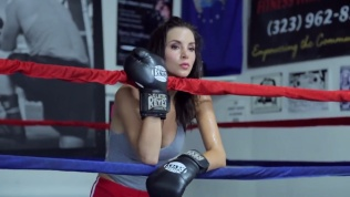 Kacey Barnfield holding the ropes of a boxing ring