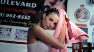 Kacey Barnfield towel dryin her hair in a boxing ring