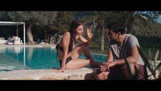 Kacey Barnfield in a bikini talkign to Antonio Magro