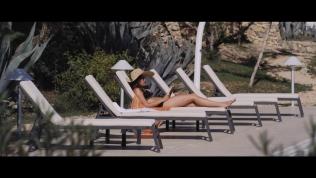 Kacey Barnfield on a sun lounger