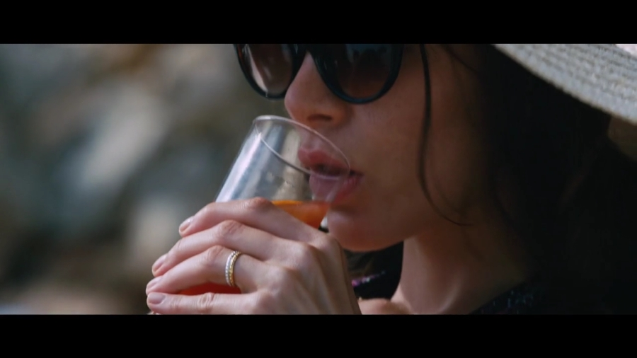Kacey Barnfield sipping from a glass