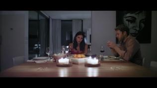 Kacey Barnfield and Ben Lamb sat at a dining table