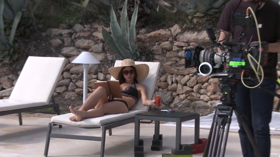 Kacey Barnfield being filmed while sunbathing