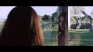 Kacey Barnfield looking out of the window