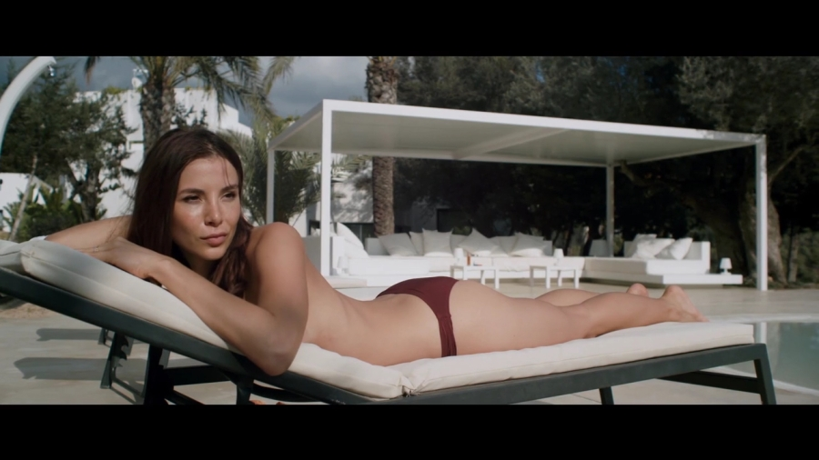 Kacey Barnfield sunbathing in bikini bottoms