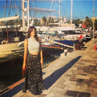 Kacey Barnfield standing at Mallorca harbour
