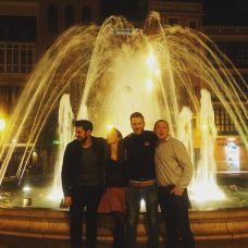 Kacey Barnfield and some of the cast and crew in front of a fountain