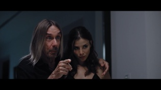 Iggy Pop pointing at Ben Lamb while his arm is around Kacey Clarke