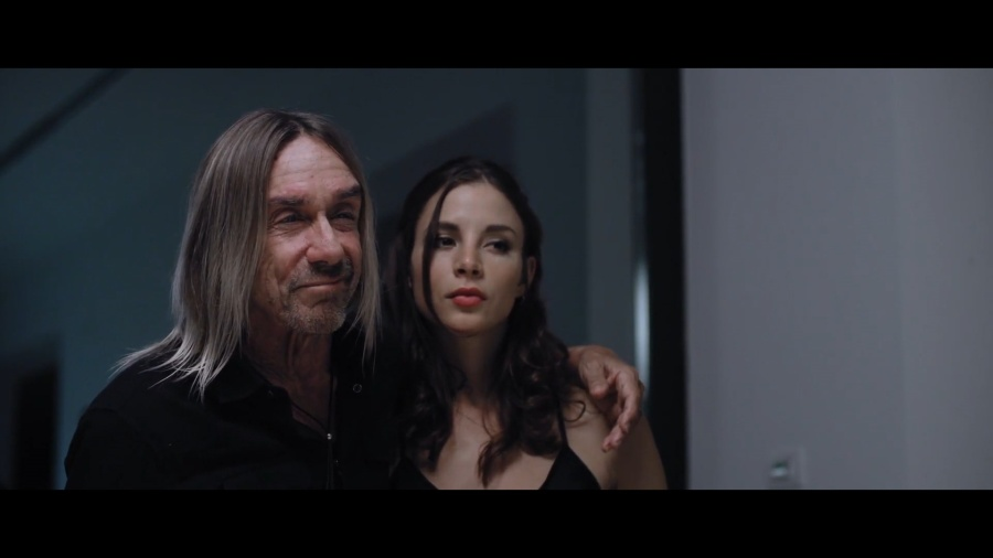 Kacey Clarke with Iggy Pop's arm around her shoulder
