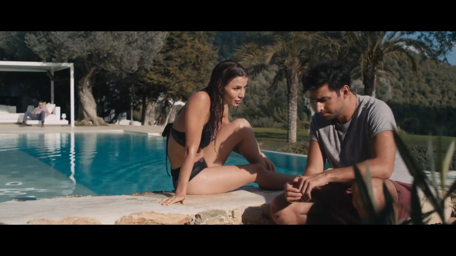 Kacey Clarke in a swimsuit talking to Antonio Magro