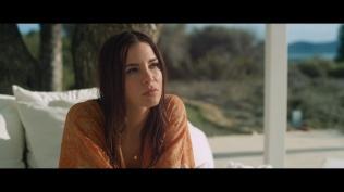 Kacey Clarke sat in a robe poolside