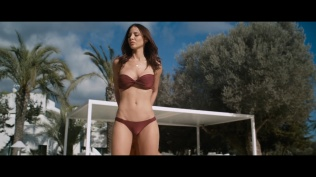 Kacey Clarke standing in front of the camera wearing a bikini swimsuit