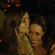 Kacey Clarke kissing her friend