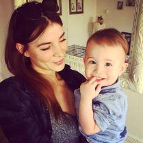 Kacey Clarke holding a little boy