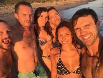 Kacey Clarke and a group of friends on the beach