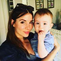 Kacey Clarke holding a baby
