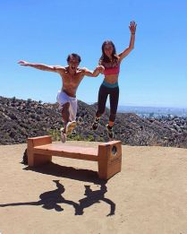 Kacey Clarke and her friend leaping in the air