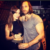 Kacey Clarke having a drink with some bloke