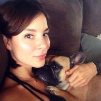 Kacey Clarke Kacey Barnfield on a sofa with a dog