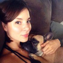 Kacey Clarke Kacey Barnfield on a sofa with a dog