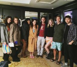 Kacey Clarke standing in the middle of the cast of 10 Year Reunion film