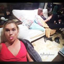 Kacey Clarke sitting in the background with Jillian Nelson in the foreground